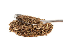 Heap of cumin seeds on the spoon isolated Royalty Free Stock Photos