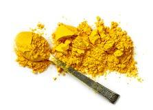 Heap of curcuma powder Stock Images