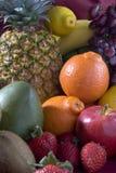 A heap of cut tropical fruits Stock Photos