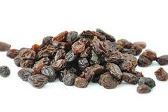Heap of dark raisins on white background Royalty Free Stock Image