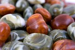 Heap of decorative stones. Stack of decorative shining colorful pebbles stock images