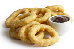 Heap of deep fried onion or calamari rings with barbecue dip iso Stock Photo