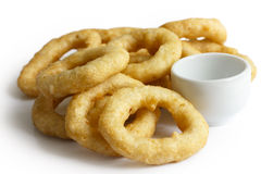 Heap of deep fried onion or calamari rings with dipping dish iso Stock Image