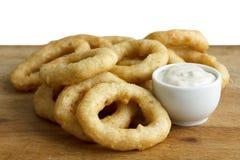 Heap of deep fried onion or calamari rings with garlic mayonnais Stock Images