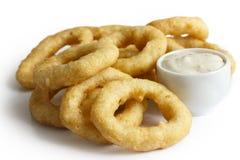 Heap of deep fried onion or calamari rings with mayonnaise dip i Royalty Free Stock Image