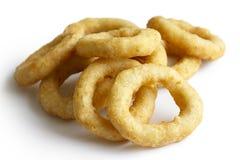 Heap of deep fried onion or calamari rings  on white. Stock Photo