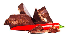 Heap of delicious black chocolate with red chili pepper Stock Image