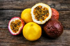 Heap of passion fruit. Heap of delicious passion t on wooden background royalty free stock photography