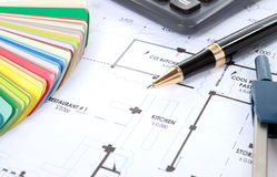 Heap of design and project drawings on table Stock Photo