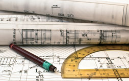 Heap of design and project drawings on table Stock Photos
