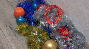 Heap of different colorful christmas and new year decorations on wooden floor Stock Image