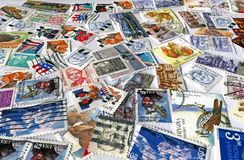 heap of different colorful post stamps, paper Royalty Free Stock Photos
