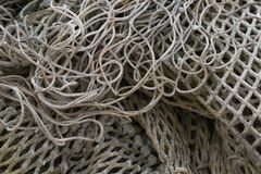 Heap of different old fishing nets royalty free stock images