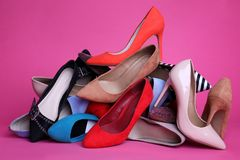 Heap of different shoes. On color background royalty free stock image