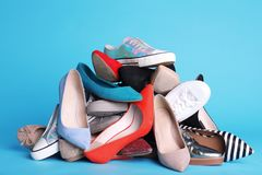 Heap of different shoes on color. Background royalty free stock image