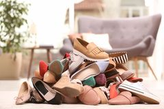 Heap of different shoes on floor. In room stock photography