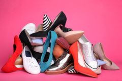 Heap of different shoes. On color background stock images