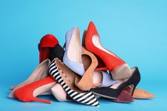 Heap of different shoes. On color background royalty free stock photos