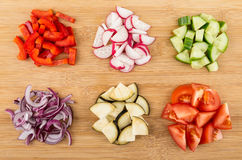 Heap of different vegetables on table. Top view. Heap of different vegetables on bamboo table. Top view Stock Photo