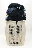 Heap of dirty clothes in busted hamper Royalty Free Stock Image