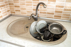 Heap of dirty dishes in the sink, in the kitchen, from above, wi Stock Photography