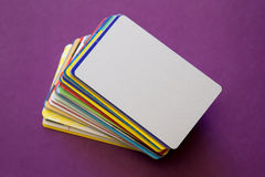 Heap of discount cards on violet background Stock Image