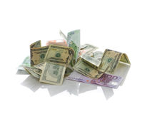 Heap of Dollar and euro Bills notes on white background Royalty Free Stock Photo