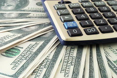 Heap of dollars and calculator Royalty Free Stock Image