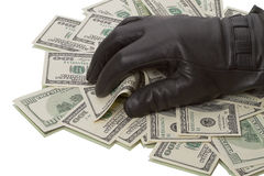 Heap dollars and hand in a black glove Stock Photography