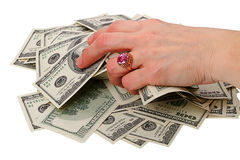 Heap dollars in hand with a ring Stock Images