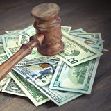 Heap Of Dollars With Judges Or Auctioneers Gavel Or Hammer. Stack Of Dollar Banknotes With Judges Or Auctioneers Gavel Or Hammer, Trial Or Tribunal Concept stock photography