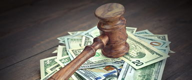 Heap Of Dollars With Judges Or Auctioneers Gavel Or Hammer. Stack Of Dollar Banknotes With Judges Or Auctioneers Gavel Or Hammer, Trial Or Tribunal Concept royalty free stock photo