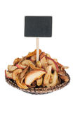 Heap of  dried apple in a plate, with a pointer for your text Royalty Free Stock Image