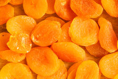Heap of dried apricots close-up food background Stock Photo