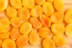 Heap of dried apricots close-up food background Stock Image
