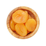 Heap of dried apricots in wood bowl from above Stock Images