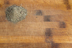 Heap of Dried Basil Flakes on Wood Background. Heap of Dried Basil Flakes Over Rustic Wooden Background with Copy Space Stock Photos