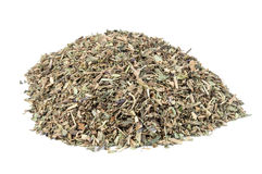 Heap of dried basil spice Stock Photography