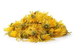 Heap of  dried calendula flowers. Isolated on white Royalty Free Stock Photos