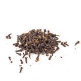 Heap of dried cloves, on white background.  royalty free stock image