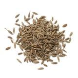 Heap of dried cumin seeds Stock Image