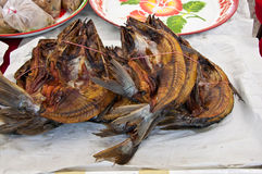 Heap of dried fish on paper Royalty Free Stock Image
