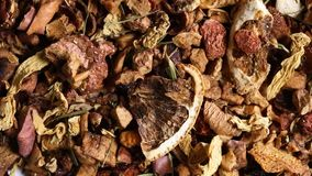 Heap of dried fruit tea from apple, lemon and strawberry rotating close up top down view from above. Heap of dried fruit tea from apple, lemon and strawberry stock video
