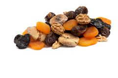 Heap of dried fruits and walnuts. Stock Images