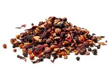 Heap of dried hibiscus petals and berries isolated on white background. Close up. High resolution royalty free stock photos
