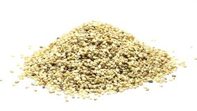 Heap of dried organic sesame seeds on white stock video