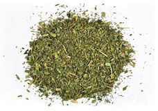 Heap of dried parsley on a white Stock Images
