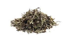 Dried, raw white tea leaves rotating over white background stock footage