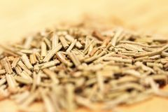 Heap of dried rosemary on a wooden background Stock Images