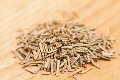 Heap of dried rosemary on a wooden background Royalty Free Stock Photo